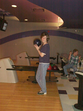Amber let's off steam with the rest of the producers at Marina Lanes (imagine the pins as . . .) Kathy & Judy producer Kurt Vanderah can be seen cheering her on in the background