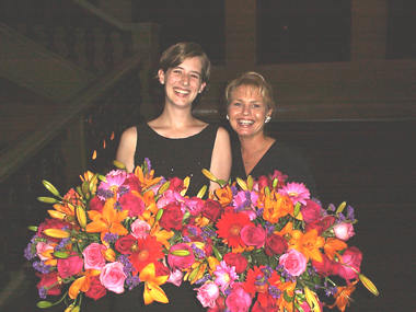 Amber (producer Audrey Clarke) and account executive Mary Jo Deisler score some centerpieces at the Radio Hall of Fame Induction Ceremony