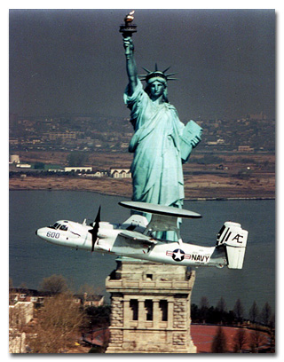 Commander Steve Silverio is at the controls for this pass in front of Lady Liberty shortly after the 1986 renovation