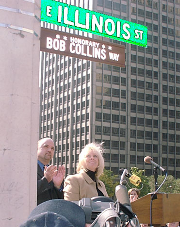 Christine Collins (Bob's wife) and Dean Richards look at the sign briefly after Christine removed the cover