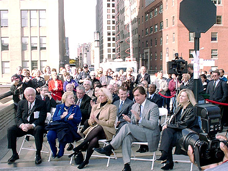 The dignitaries gathered for the dedication of Bob Collins Way and the unveiling of the street's sign. (Front row l-r: Gov. Ryan and his wife, Bob's wife Christine Collins, WGN Radio GM Steve Carver, WGN Radio PD Mary June Rose. Second Row l-r: Chicago Ald. Burton Natarus, former Illinois Governor Jim Edgar and wife, Illinois House Democratic Leader Michael Madigan. Also in the background: US Rep. Henry Hyde, Salvation Army rep Bob Bonesteel, Sect. of State Jesse White, Chicago Bears owners Ed and Michael McCaskey, WGN Radio reporter Larry Schreiner and many listeners and staff)