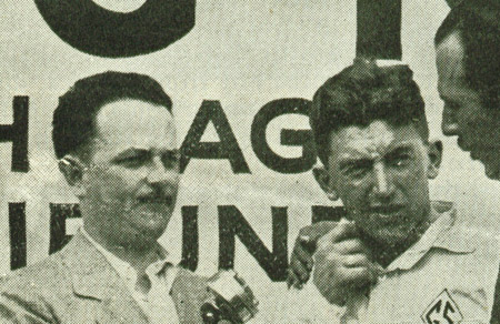 Moments after the conclusion of the race, Quin Ryan prepares to talk with the winner of the 1927 Indianapolis 500, George Souders.