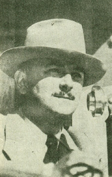 Quin Ryan at the WGN microphone during a broadcast of a Michigan vs. Minnesota football game.