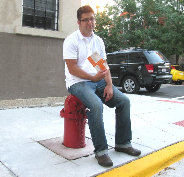 Outside the Loop host Mike Stephen shows off one of his many City of Chicago parking tickets. [circa September 2013]