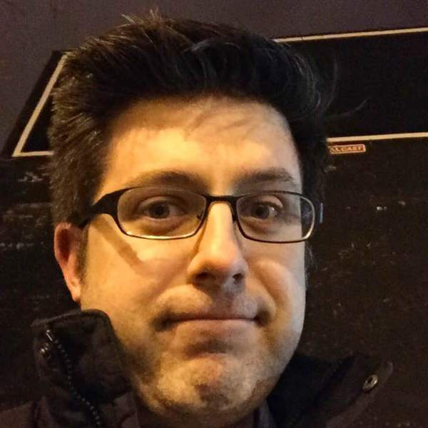 OTL host Mike Stephen takes a selfie under a blacked-out billboard in Logan Square.