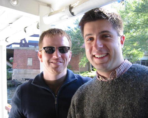 Future OTL producer Andy Hermann and host Mike Stephen cruise the Chicago River post-flow reversal and pre-Asian carp threat. [circa September 2005]