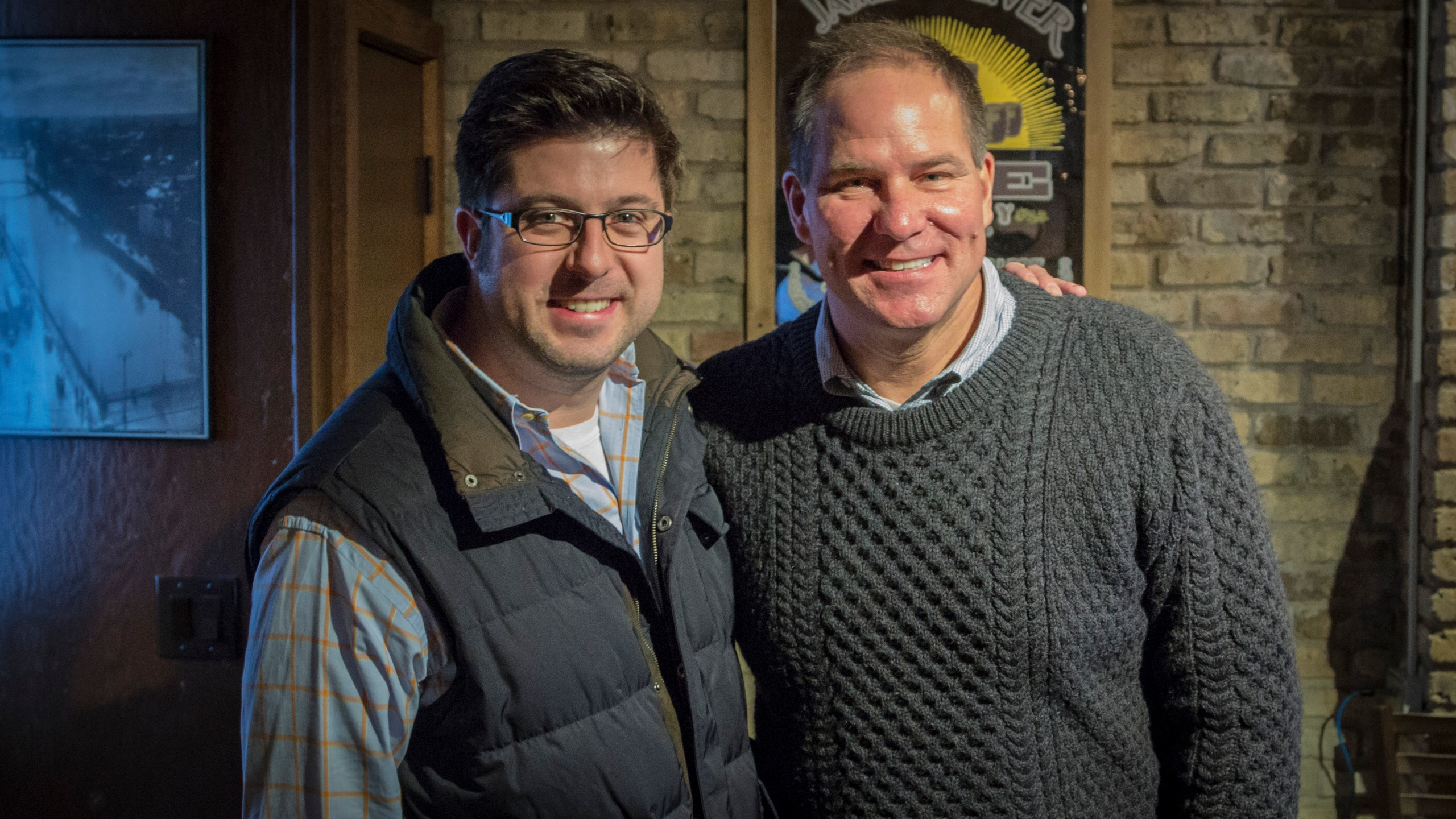 "OTL host Mike Stephen and Mr. Fix-It host Lou Manfredini, fellow ""Chi-lebrities,"" pose for the paparazzi at a remote at The Hidden Shamrock in Lincoln Park. [photo circa December 13, 2014]"