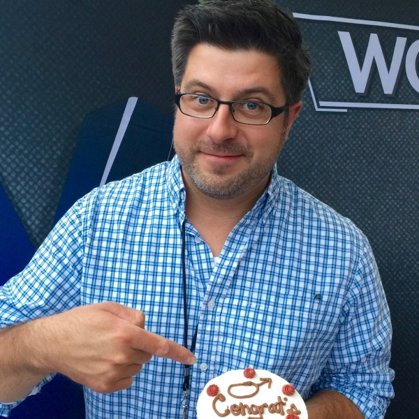 Outside the Loop host Mike Stephen can't wait to dig into his OTL-themed 10th anniversary cake provided by Mr. Fix-It producer Lindsey Smithwick and host Lou Manfredini.