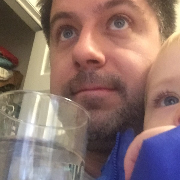 "OTL host Mike Stephen III and his son Mike Stephen IV watch an episode of Elmo's World while enjoying a tall glass of Chicago tap water. (Text ""LEAD"" to 312-697-1791 to find out more about potential lead poisoning in your area.)"
