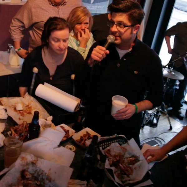 OTL host Mike Stephen serves as MC and milk slinger at the 4th Annual Wing Fling at Toons Bar & Grill! [photo circa 2015]