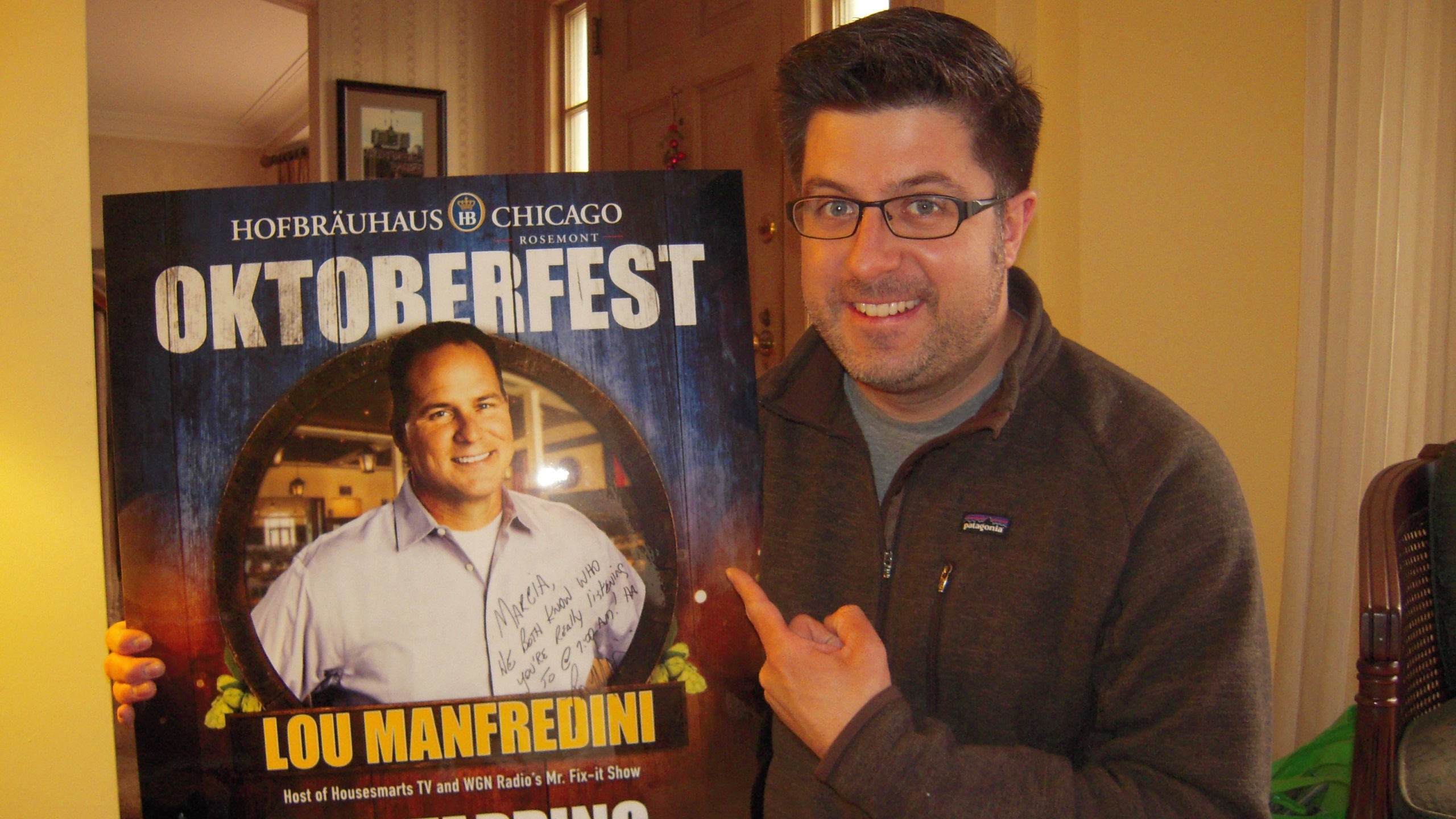 OTL host Mike Stephen poses with his mom's prized Lou Manfredini poster. [not pictured: Mrs. Stephen]