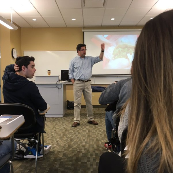 OTL host Mike Stephen spoke at the 2017 Northern Illinois Scholastic Press Association (NISPA) high school journalism conference about... tacos. Check out the screen behind him. [photo courtesy @EldesAyse]