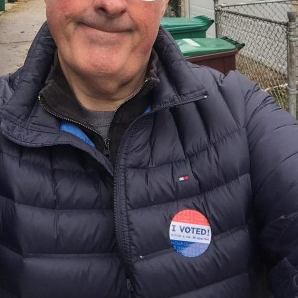 """Brian Noonan shows off his """"I Voted"""" sticker"""