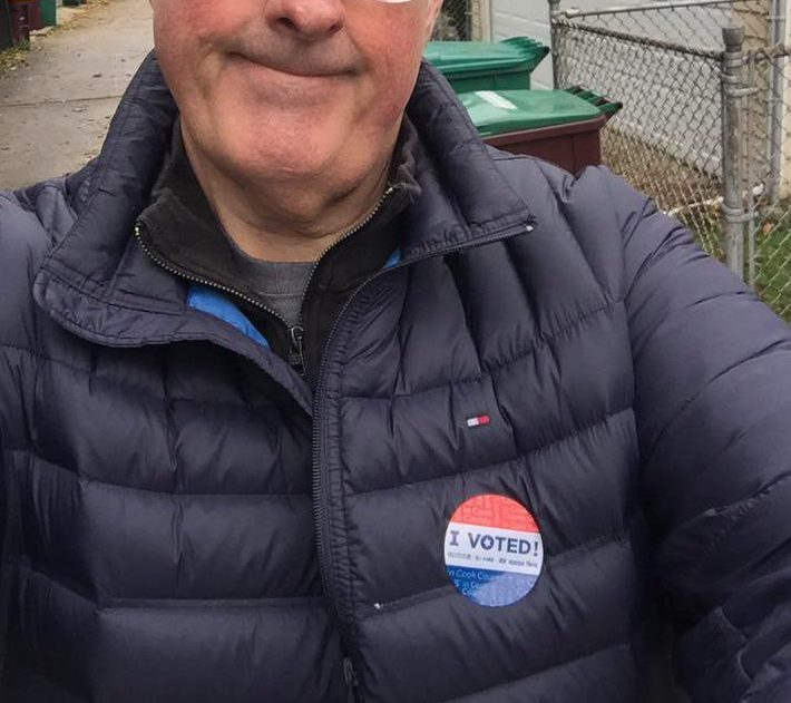 "Brian Noonan shows off his ""I Voted"" sticker"