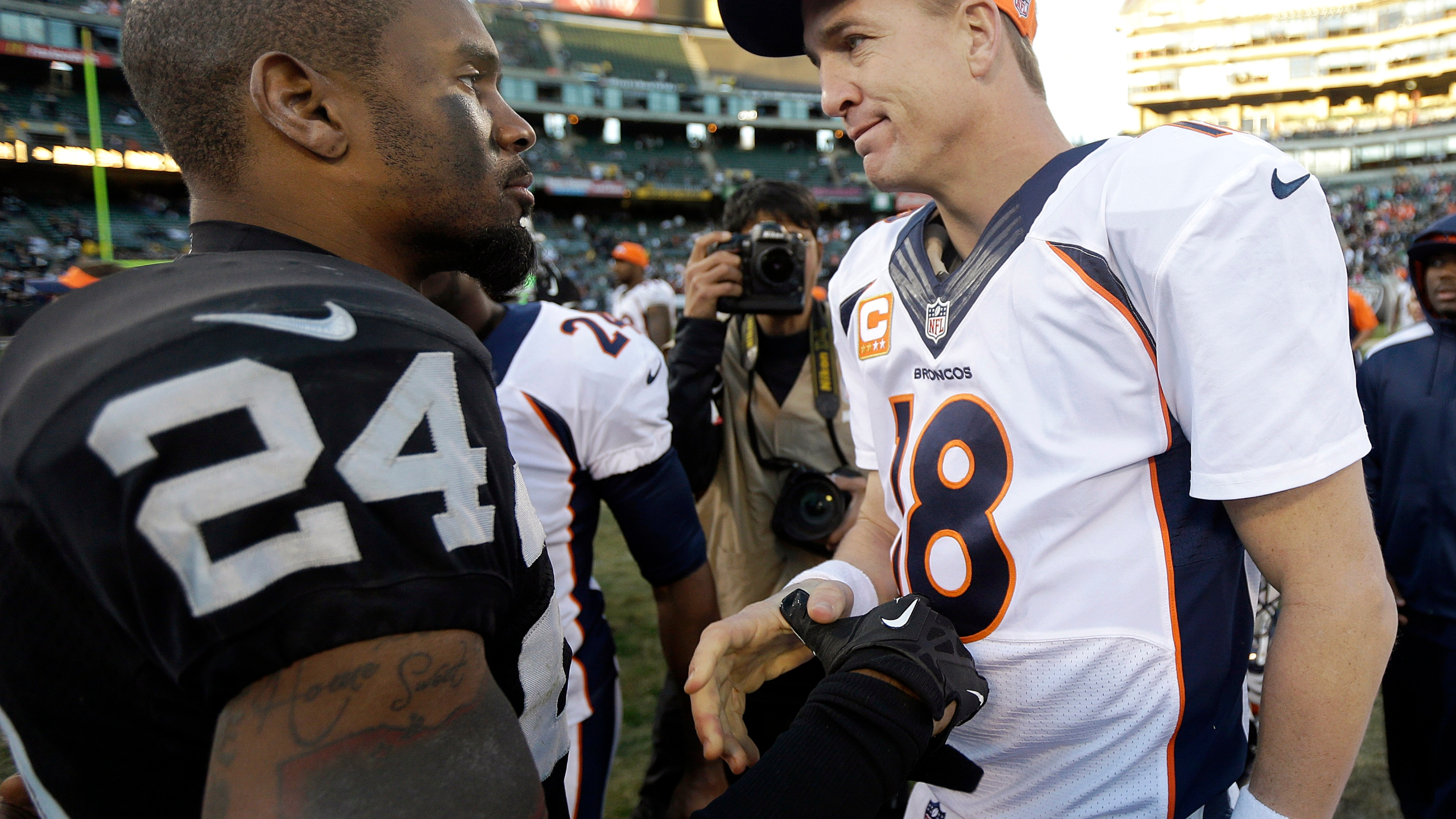 Charles Woodson, Peyton Manning